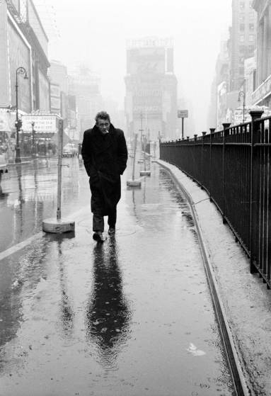 "1955 | Hunkering against the cold and rain, a haunted-looking James Dean strolls through Times Square, mere blocks from the famous Actors Studio where he and other legends-to-be studied ""the Method."" Originally published in the March 7, 1955, issue of LIFE."